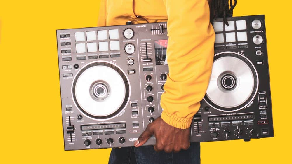 Man carrying a CDJ controller